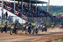 Start of the Hooligan flat track finals at the Spirit of Sturgis races at the fairgrounds during the Sturgis Black Hills Motorcycle Rally. Sturgis, SD, USA. Monday, August 5, 2019. Photography ©2019 Michael Lichter.