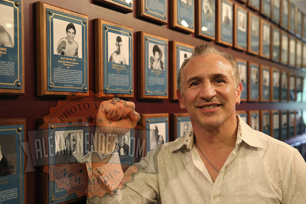 CANASTOTA, NY - JUNE 14: Boxing champion Ray Mancini poses with his new ring and photo on the wall after the induction ceremony at the International Boxing Hall of Fame induction Weekend of Champions events on June 14, 2015 in Canastota, New York. (Photo by Alex Menendez/Getty Images) *** Local Caption *** Ray Mancini