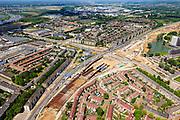 Nederland, Limburg, Maastricht, 27-05-2013; bouwwerkzaamheden voor de A2 traverse, De Groene Loper. <br /> Kruispunt Geusselt met  tunnelbouwkuip, naar linksonder het verkeer richting centrum.<br /> De snelweg A2 gaat ondergronds, er <br /> De snelweg A2 gaat ondergronds, er wordt een gestapelde tunnel gebouwd (2 wegen boven elkaar). Het plan moet voor een betere bereikbaarheid en leefbaarheid van Maastricht zorgen en ook voor een betere doorstroming op de A2.<br /> Construction works for motorway A2 crossing Maastricht, the so-called Green Carpet.<br /> The A2 motorway goes underground, a stacked tunnel is  built with two roads above each other). The plan should provide better accessibility and traffic flow.<br /> luchtfoto (toeslag op standard tarieven);<br /> aerial photo (additional fee required);<br /> copyright foto/photo Siebe Swart.