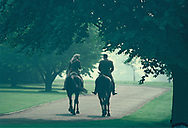 Windsor, England, June, 1982: President Ronald Reagan and Queen Elizabeth II head out on an hour-long horseback tour of the Windsor Castle grounds. Reagan is riding Centennial, a gift to the queen from the Royal Canadian Mounted Police; Elizabeth is riding her 20-year-old horse, Burmese<br />Photograph by Dennos Brack  bb77