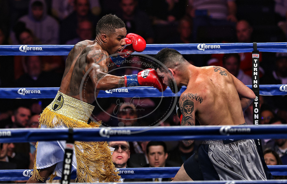 16 January 2015: Bryan Vera (R) is punched by Willie Monroe Jr. (L)  during their NABA/NABO middleweight championship fight at the Turning Stone Resort Casino in Verona, NY.