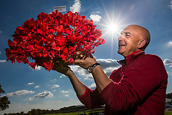© Licensed to London News Pictures. 17/09/2015. Harrogate, UK. Picture shows grower David Mathewman with the Harrogate Gem sweet pea he has bred to celebrate the 40th Harrogate Autumn Flower show. Photo credit: Andrew McCaren/LNP