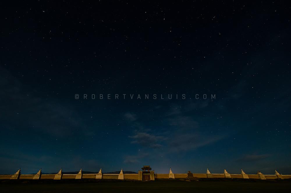 Starry sky over the eastern gate of Erdenee Zuu Monastery, Kharkhorin, Mongolia. The wall is lit by the light of the rising full moon. Photo © Robert van Sluis