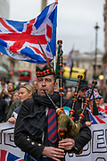 January 31, 2020, England, United Kingdom: Dozens of Brexit supporters march through Trafalgar Square to celebrate Britain's departure from the EU in London, Friday, Jan. 31, 2020. Britain officially leaves the European Union on Friday after a debilitating political period that has bitterly divided the nation since the 2016 Brexit referendum. (Credit Image: © Vedat Xhymshiti/ZUMA Wire)