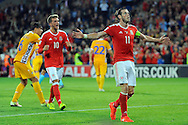Gareth Bale celebrates after scoring his second and Wales' 4th goal from the penalty spot against Moldova. Wales v Moldova , FIFA World Cup qualifier at the Cardiff city Stadium in Cardiff on Monday 5th Sept 2016. pic by Carl Robertson, Andrew Orchard sports photography