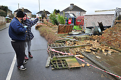 © Licensed to London News Pictures. 28/03/2016<br /> This Orpington couple have lost 40 meters of their garden wall to the storm, they are now waiting for the council and insurance to assess the damage.<br /> Storm Katie damage in Orpington, Kent.<br /> Winds up to 80 mph have battered the UK over night.<br /> <br />  (Byline:Grant Falvey/LNP)