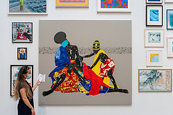 © Licensed to London News Pictures. 15/09/2021. LONDON, UK. 'OUBLIEZ LE PASSÉ ET VOUS PERDEZ LES DEUX YEUX' by Eddy Kamuanga Ilunga, price Not For Sale. Preview of the Summer Exhibition 2021 at the Royal Academy of Arts in Piccadilly. Co-ordinated by Yinka Shonibare RA, the exhibition explores the theme of 'Reclaiming Magic' to celebrate the joy of creating art with around 1400 works by emerging and established artists featured in the exhibition.  The Summer Exhibition is the world's largest open submission contemporary art show and has taken place every year without interruption since 1769.  Photo credit: Stephen Chung/LNP