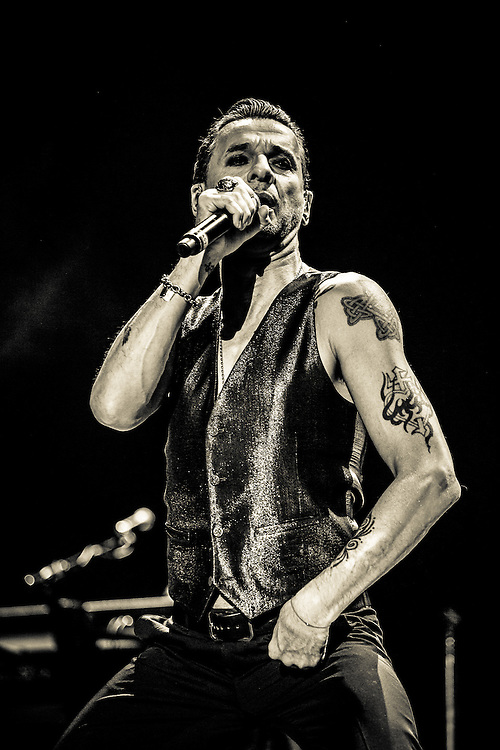 DEPECHE MODE performing at Lanxess Arena, Cologne.  Dave Gahan (lead vocals, occasional songwriter since 2005), Martin Gore (keyboards, guitar, vocals, chief songwriter after 1981), Andy Fletcher (keyboards).
