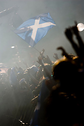 Saltire flag in the crowd as The Editors play on the main stage..Rock Ness 2008, Inverness.©2008 Michael Schofield. All Rights Reserved.
