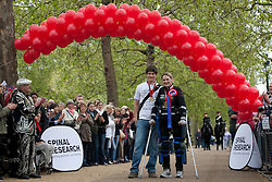 © licensed to London News Pictures. London, UK 08/05/2012. Claire Lomas, who paralysed from the chest down after an accident, finishes the London Marathon and posing with her husband Dan Spincer, today after 16 days with a robotic suit to raise money for Spinal Research (08/05/12). Photo credit: Tolga Akmen/LNP