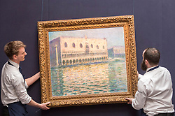 """© Licensed to London News Pictures. 20/02/2019. LONDON, UK. Technicians prepare to hang """"Le Palais Ducal"""", 1908, by Claude Monet (Est. £20-30m). Preview of Sotheby's Impressionist & Modern and Surrealist Art sales.  The auction will take place at Sotheby's New Bond Street on 26 February 2019.  Photo credit: Stephen Chung/LNP"""
