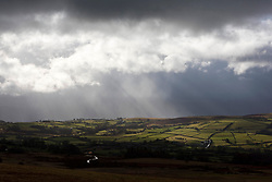 © Licensed to London News Pictures. 13/03/2021. Hay-on-Wye, Powys, Wales, UK. Very strong winds, sleet, rain and very cold temperatures hit Mid Wales, UK. A stormy landscape near Hay-on-Wye in Powys, Wales, UK. Photo credit: Graham M. Lawrence/LNP
