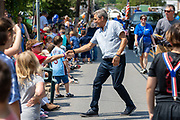 Republican candidate for Pennsylvania governor and former congressman Lou Barletta stops to shake hands as he walks in the Independence Day Parade in Millville, Pennsylvania on July 5, 2021.