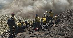 The Granite Mountain Hoteshots overlook a fire in Columbia Pictures' ONLY THE BRAVE.