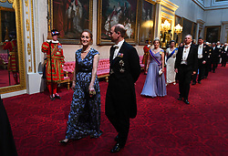 Mrs Hammond and the Earl of Wessex arrive through the East Gallery during the State Banquet at Buckingham Palace, London, on day one of the US President's three day state visit to the UK.