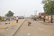 Nov. 18, 2015 - Kano, Nigeria - <br /> <br /> Female Suicide Bombers Strike Nigeria<br /> <br /> police keep people away from the scene of the bombing at the Farm centre phone market in Kano, Nigeria on 18th November 2015.<br /> ©Exclusivepix Media