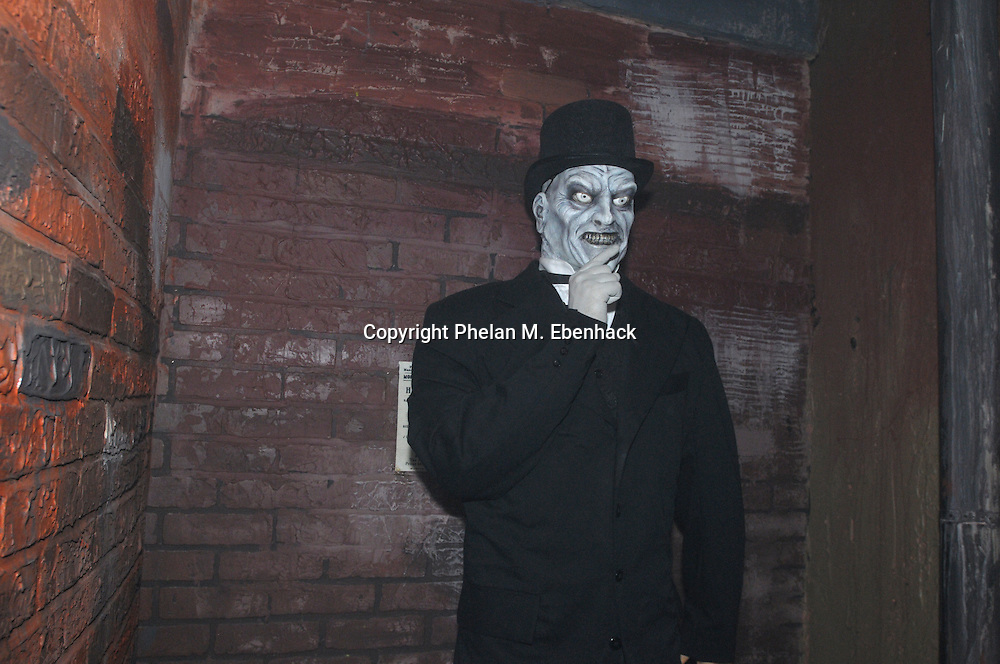 A ghoul stands in a corner in the Body Collectors: Collections of the Past venue during a dress rehearsal of Universal Studios Florida's Halloween Horror Nights in Orlando, Fla., Tuesday, Sept. 16, 2008.