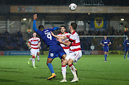 AFC Wimbledon striker Kweshi Appiah (9) getting fouled whilst battles for possession during the The FA Cup match between AFC Wimbledon and Doncaster Rovers at the Cherry Red Records Stadium, Kingston, England on 9 November 2019.