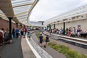 People shopping at the Sunday market on Folkestone Harbour Arm on the 25th of July 2021 in Folkestone, United Kingdom. The harbour company have restored the old railway station into an open air walkway with overhanging glass canopies. There is now a bustling market there every Sunday full of boutique stalls from local artists and designers.(photo by Andrew Aitchison / In pictures via Getty Images)