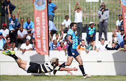 Robbie Louw of Boland dives in vane as Bjorn Basson of the Blue Bulls slips through to score during the Currie Cup premier division match between the Boland Cavaliers and The Blue Bulls held at Boland Stadium, Wellington, South Africa on the 23rd September 2016<br /> <br /> Photo by:   Shaun Roy/ Real Time Images