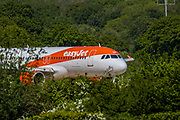 EasyJet plane is seen about to take-off from Gatwick airport runway on Wednesday, May 6, 2020. (Photo/Vudi Xhymshiti)