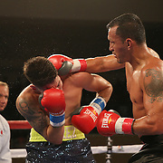 Jovan Perez (L) fights against Juan Aguirre during a Telemundo boxing match at the Kissimmee Civic Center on Friday, July 17, 2015 in Kissimmee, Florida.  Perez won the bout. (AP Photo/Alex Menendez)