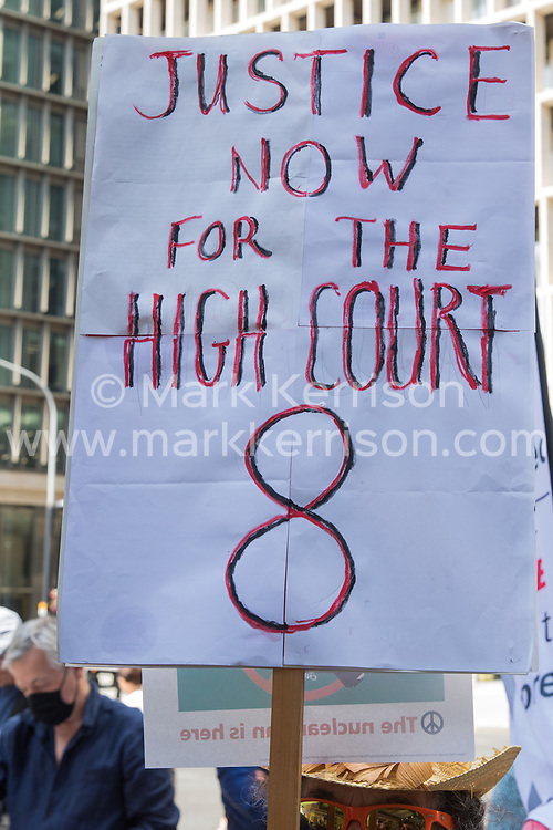 London, UK. 20th July, 2021. A woman holds a placard calling for justice for eight current or former Labour Party members who lost a High Court claim against the party over its disciplinary process for investigating anti-Semitism complaints during a protest lobby outside the party's headquarters by supporters of left-wing groups. The lobby was organised to coincide with a Labour Party National Executive Committee meeting during which it was asked to proscribe four organisations, Resist, Labour Against the Witchhunt, Labour In Exile and Socialist Appeal, members of which could then be automatically expelled from the Labour Party.