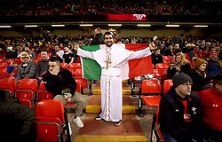 An Italy fan dressed in fancy dress during the Guinness Six Nations match at the Principality Stadium, Cardiff.