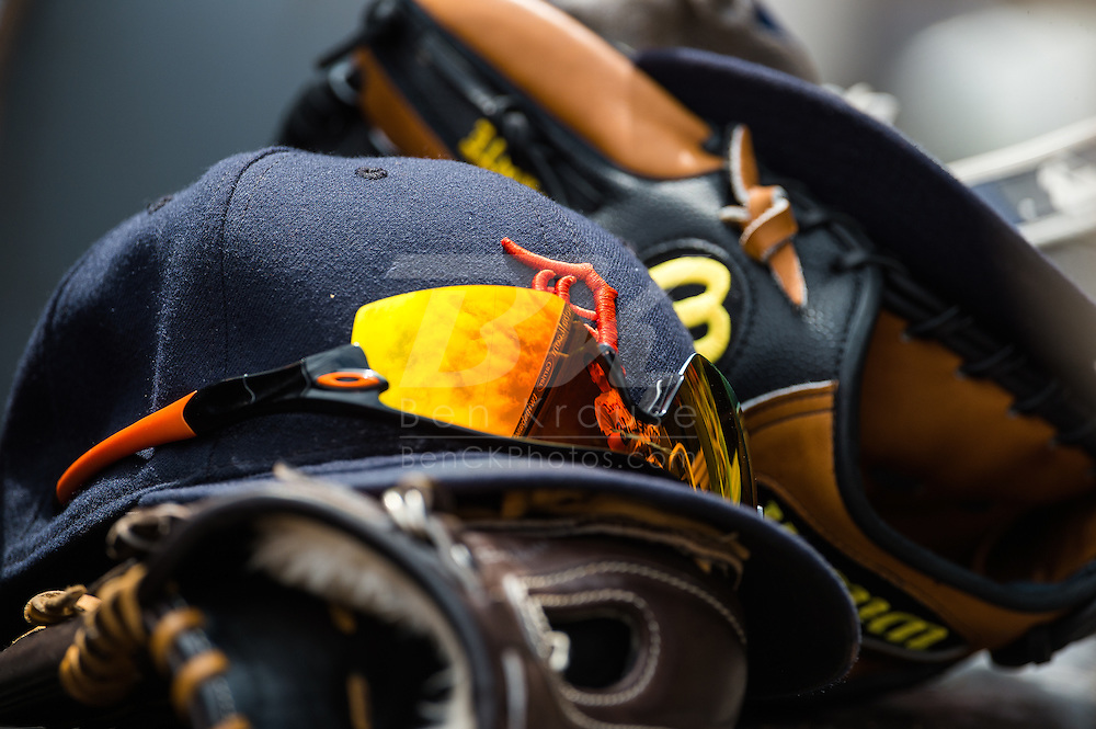 A close up view of sunglasses, hats, and gloves in the dugout of the Detroit Tigers during a game against the Minnesota Twins on August 15, 2012 at Target Field in Minneapolis, Minnesota.  The Tigers defeated the Twins 5 to 1.  Photo: Ben Krause