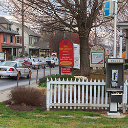 Intercourse, PA, USA - March 20, 2012: A pay phone and horse tie stand used by the Amish on the main street in Intercourse, PA.