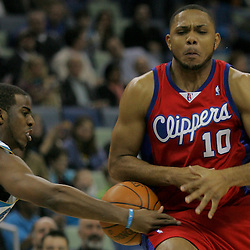 Jan 13, 2010; New Orleans, LA, USA; New Orleans Hornets guard Chris Paul (3) steals the ball from Los Angeles Clippers guard Eric Gordon (10) during the first quarter at the New Orleans Arena. Mandatory Credit: Derick E. Hingle-US PRESSWIRE