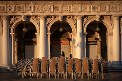 A general view of cafe chairs stacked up on St Mark's Square at sunrise in Venice. From a series of travel photos in Italy. Photo date: Tuesday, February 12, 2019. Photo credit should read: Richard Gray/EMPICS