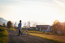 THEMENBILD - eine junge Frau fährt auf einem Damenfahrrad auf einem Feldweg bei Sonnenuntergang, aufgenommen am 18. April 2018 in Kaprun, Österreich // a young woman rides on a ladies bike on a dirt road at sunset, Kaprun, Austria on 2018/04/18. EXPA Pictures © 2018, PhotoCredit: EXPA/ JFK