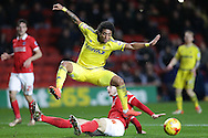 Harry Lennon of Charlton Athletic challenges Ryan Mendes of Nottingham Forest (c). Skybet football league championship match, Charlton Athletic v Nottingham Forest at The Valley  in London on Saturday 2nd January 2016.<br /> pic by John Patrick Fletcher, Andrew Orchard sports photography.