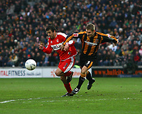 Photo: Andrew Unwin.<br />Hull City v Middlesbrough. The FA Cup. 06/01/2007.<br />Hull's Andy Dawson (R) tussles with Middlesbrough's Julio Arca (L).