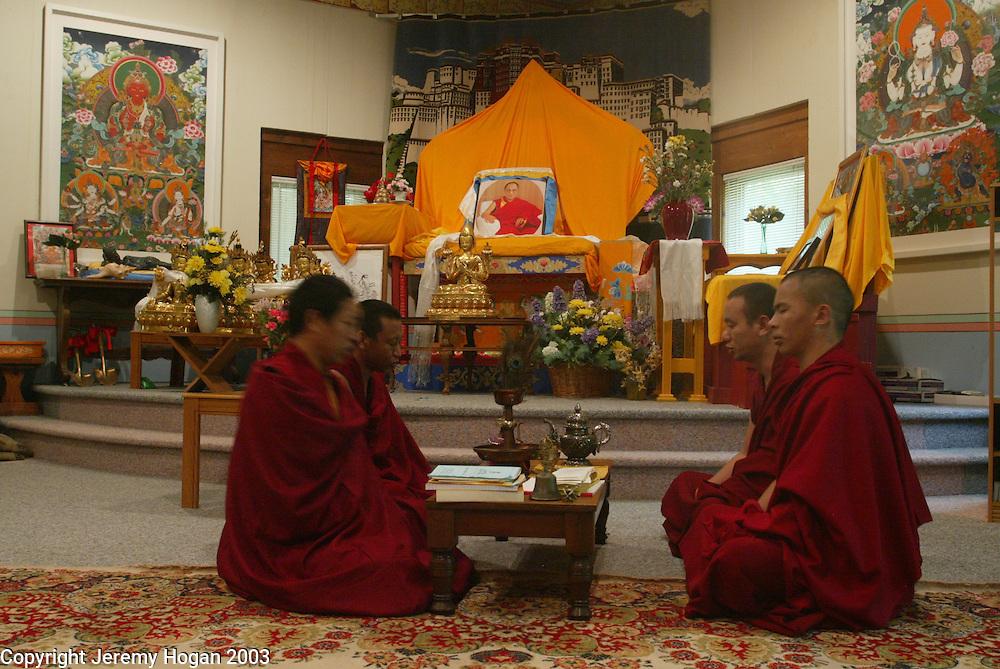 Tibetan Buddhist monks perform morning prayers at the Tibetan Culture Center.