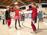 Gilford Elementary School's physical education teacher Meloday Chase jumps rope with third grade students Marissa Bogannan and Lauren Sikoski during Wednesday's Jump for Heart event.  (Karen Bobotas/for the Laconia Daily Sun)