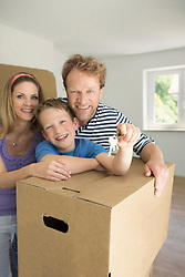 Young family happy new home house keys