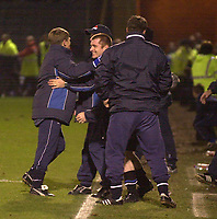 Photo. Glyn Thomas.<br /> Gillingham v Charlton. FA Cup Third Round.<br /> Priestfield Stadium. 03/01/2004.<br /> Gillingham's manager celebrates his side's win with the rest of the bench.