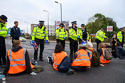 """© Licensed to London News Pictures. 27/10/2021. London, UK. Protesters from climate campaign 'Insulate Britain', an offshoot of Extinction Rebellion (XR), block traffic on the A40 Western Avenue in Acton. Following a national injunction covering England's highways, Insulate Britain declared the M25 """"a site of nonviolent civil resistance"""" vowing to return to the motorway network to continue their protest action. Photo credit: Peter Manning/LNP"""