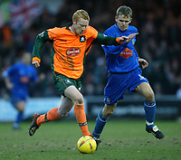 Photo. Aidan Ellis.<br /> Stockport County v Plymouth Argyle.<br /> Nationwide Division 2.<br /> 24/01/2004.<br /> Plymouth's Nathaen Lowndes and Stockport's Robert Clare