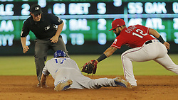 May 25, 2018 - Arlington, TX, USA - Kansas City Royals first baseman Hunter Dozier (17) doubles on a line drive to center field in the sixth inning while Texas Rangers second baseman Rougned Odor (12) tries to make the tag as the Kansas City Royals play the Texas Rangers at Globe Life Park in Arlington, Texas, Friday, May 25, 2018. (Credit Image: © Rodger Mallison/TNS via ZUMA Wire)