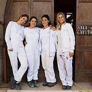Treviso, Italy, September 20, 2017. Bishop's Seminary of San Nicolò. A group photo of young restorers during  a work break. From the left to right: Sofia, Cecilia, Rebecca and Giovanna, students at the 2nd year of the Professional Training Course 1 (Stone Materials and Derivatives, Decorated Architecture Surfaces) of the Istituto Superiore per la Conservazione ed il Restauro of Rome and Matera.<br /> 