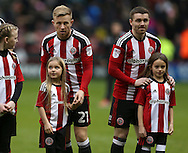 Mark Duffy of Sheffield Utd and John Fleck of Sheffield Utd  with mascots during the English League One match at Bramall Lane Stadium, Sheffield. Picture date: December 31st, 2016. Pic Simon Bellis/Sportimage