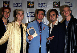 American boy band N'Sync pose with Favourite New Artist Award at the 5th Annual Blockbuster Awards in 1999. The ceremony was held at the Shrine Auditorium in L.A. (L-R) Joey Fatone, Lance Bass, J.C. Chasez Chris Kirkpatrick and Justin Timberlake.