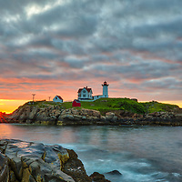 Cape Neddick Light and Boom Island Light far in the distance taken at sunrise in York, ME. Loved watching this sunrise and capturing a sun star of the rising sun while the first light created a beautiful sky across one of Maine's most scenic lighthouses, Nubble Light. Early morning is my favorite time of the day, when I can enjoy quietude and solitude.<br /> <br /> Maine Cape Neddick Light fine art photography is available as museum quality photography prints, canvas prints, acrylic prints or metal prints. Prints may be framed and matted to the individual liking and room decor needs:<br /> <br /> https://juergen-roth.pixels.com/featured/cape-neddick-light-and-boom-island-light-juergen-roth.html<br /> <br /> My best,<br /> <br /> Juergen<br /> Prints: http://www.rothgalleries.com<br /> Photo Blog: http://whereintheworldisjuergen.blogspot.com<br /> Instagram: https://www.instagram.com/rothgalleries<br /> Twitter: https://twitter.com/naturefineart<br /> Facebook: https://www.facebook.com/naturefineart