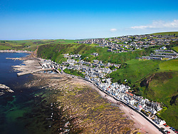 Aerial view from drone of  historic village of Gardenstown on Moray firth Coast in Aberdeenshire, Scotland, Uk