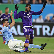 Kevin Molino, Orlando, is tackled by Federico Bravo, NYCFC, during the New York City FC Vs Orlando City, MSL regular season football match at Yankee Stadium, The Bronx, New York,  USA. 18th March 2016. Photo Tim Clayton