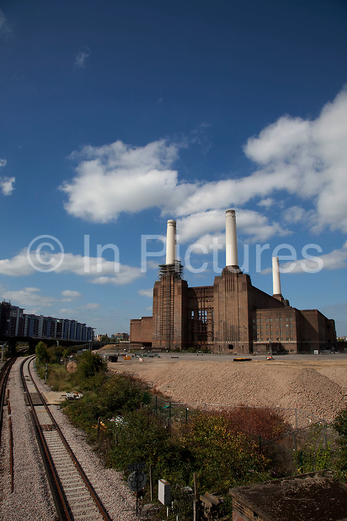 Battersea Power Station as seen from Battersea Park Road, West London. This derelict building is an Art Deco icon of London with it's distinctive four towers.