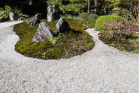 Kurodani Konkai Komyo-ji -  Shiun-no-niwa and Goen-no-michi were created surrounding a pond called Oike at Konkai-Komyo-ji Temple, the head temple of the Jodo sect.  The Shiun-no-niwa was created to commemorate the 800th anniversary of the death of Honen Shonin, the founder of the Jodo sect. It is a Japanese dry garden that depicts the life of Honen expressed with stones.  The garden is covered in white sand and hair moss.  The Goen-no-michi was created as a garden expressing Goen which means connection, is one of the basic concepts of Buddhism advocated by Honen. In the garden, two paths connect into one path representing the aspect of connection.